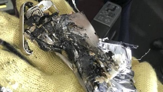 Remnants of a mobile phone which was accidentally crushed in a passenger plane seat and then caught fire in a previous incident